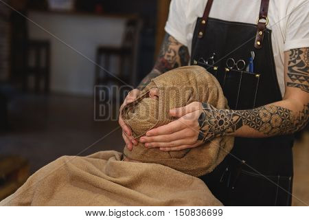 hot and cold compresses on face in a old style, ritual and concept of shaving
