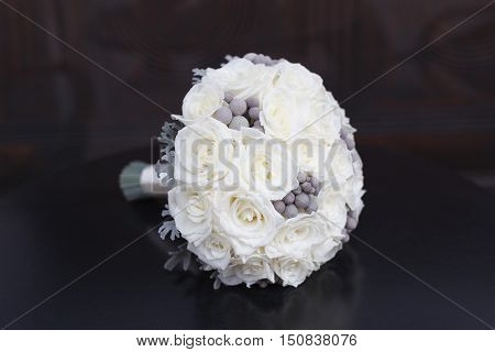 White roses and grey brunia bridal bouquet