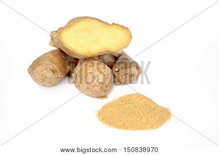 Fresh ginger root and ground ginger isolated spice on white background