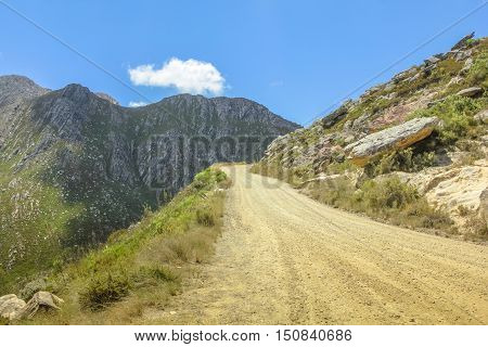 Mountain dirt road in Mountain Zebra National Park in summer, Eastern Cape province of South Africa. African safari in 4x4 in Great Karoo desert.