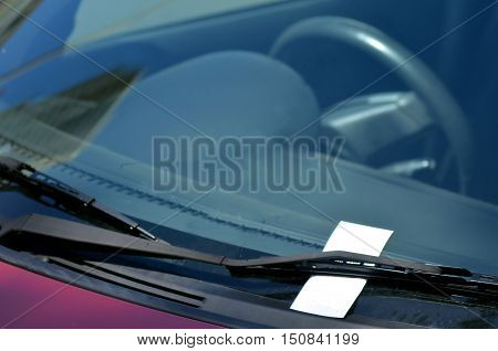 Parking ticket on car windscreen. transportation and vehicle concept