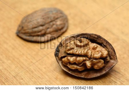 Cracked Juglans regia walnut close Up food background