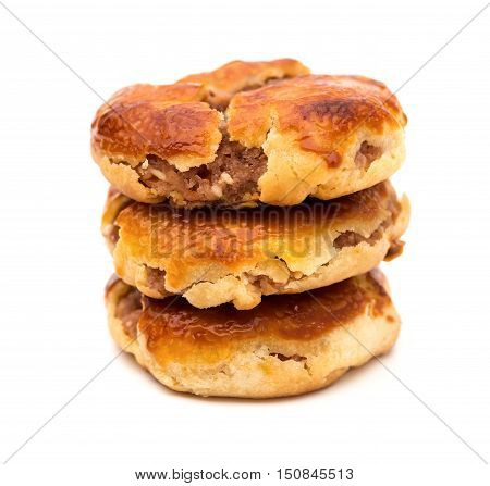 side view sweet mini chewy cakes or chickee cakes stacked up on white background