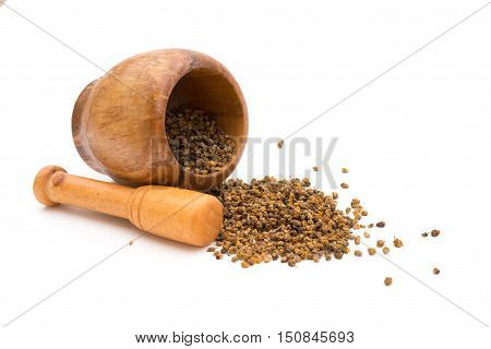 wooden mortar and pestle with flos chrysanthemi indic on white background