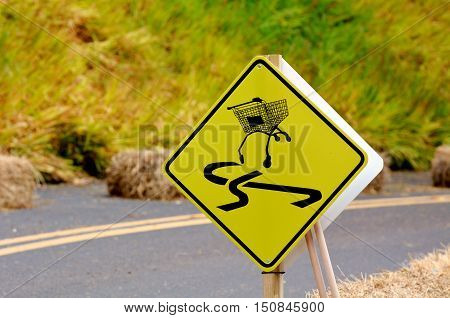 Dangerous Slippery Road Sign Of Shopping Trolley On The Roadside