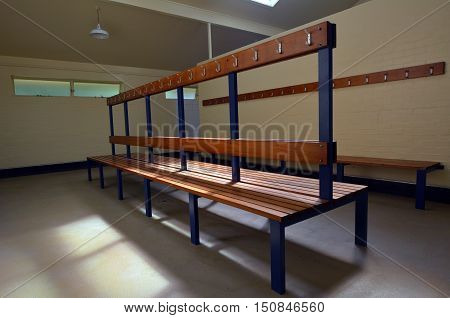 An empty interior of a public changing room.