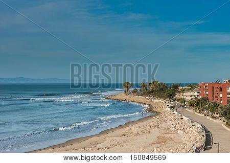 Ventura promenade boardwalk along the high tide shore.