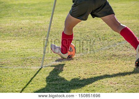 kids playing soccer, corner kick on grass field