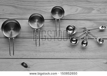 Flat Lay Of Stainless Steel Measuring Cups And Stainless Steel Measuring Spoon Set