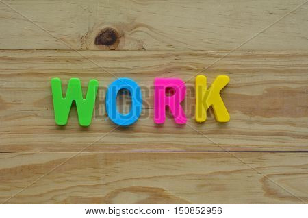 Top Lay Of The Word Work On A Wooden Background