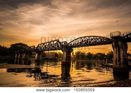 The death railway bridge is a history of world war ii the death railway bridge over Kwai river built by Japanese soldiers at sunrise time Kanchanaburi Thailand