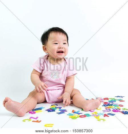 Asian Baby With Wooden Alphabets
