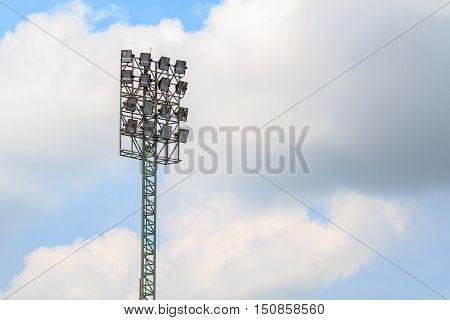 Sport stadium floodlights on a cloudy background. Soccer stadium lighting.