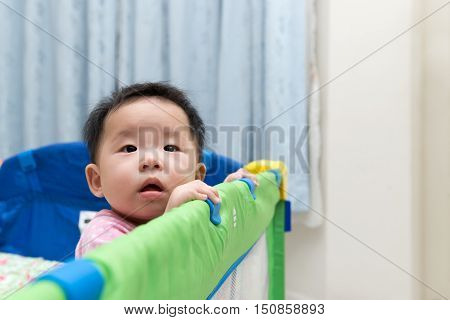 Asian Baby In Playpen