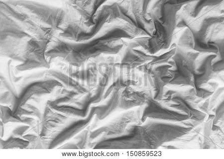 Close up on black and white tone color background of white wrinkled cotton blanket