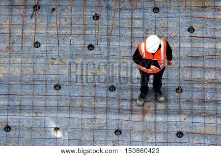 Civil Engineer Inspecting The Work Progress In A Construction Site
