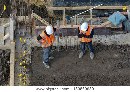 Civil Engineers Inspecting The Work Progress In A Construction Site