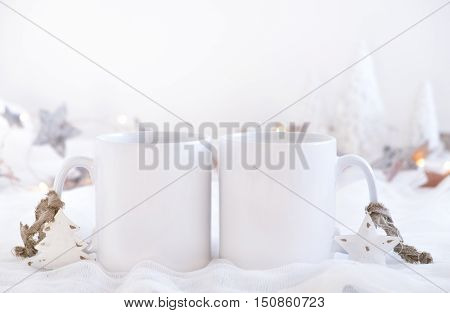 Christmas mock up styled stock product image Christmas scene with two white blank coffee mugs that you can overlay your custom design or quote on to.