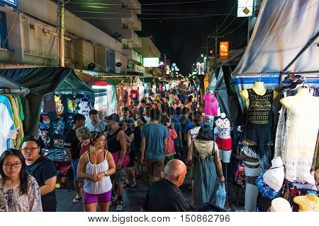 Hua Hin Thailand - Dec 28 2015: People on night market on Hua Hin street Thailand. Night food and apparel markets are part of Asian culture and much loved by locals and tourist