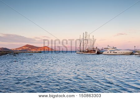 NAXOS, GREECE - SEPTEMBER 23, 2016: Boats in the port of Naxos early in the morning on September 23, 2016.
