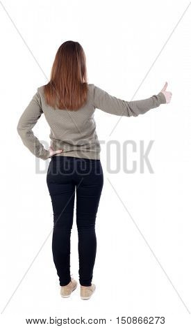 Back view of  woman thumbs up. Rear view people collection. backside view of person. Isolated over white background. slender blonde in a jeans shows the symbol of success or hitchhiking. left-handed