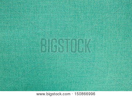 Textile Texture Close Up of Green Cotton Fabric Pattern Background in Pastel Colors Tone.