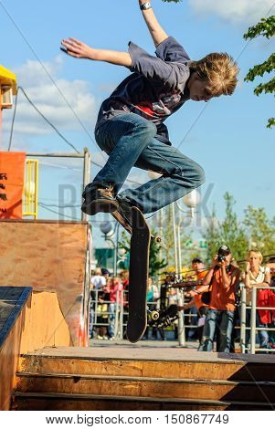 Tyumen, Russia - July 26, 2007: Cvetnoy Bulvar park. Second stage of competitions in extreme sports. Siberian games 2007. The skateboarder shows the skill