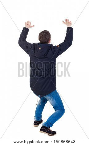back view. man  in parka protects hands from what is falling from above. Man holding a heavy load Rear view people collection.  backside view of person.  Isolated over white background. The guy is on
