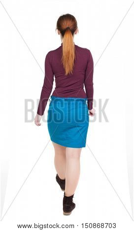 side view of walking  woman in dress. beautiful girl in motion.  backside view of person.  Rear view people collection. Isolated over white background. red-haired girl with long hair goes away