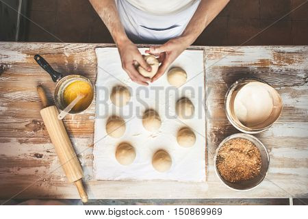 Chef preparing dough in a kitchen. Ingredients for cooking flour products or dough (bread muffins pie pizza dough).