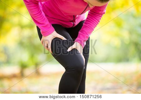 Hands grabbing a hip, ache pose, sport injury situation. Concept photo