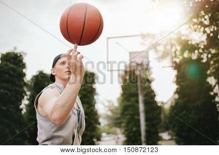 Streetball Player Spinning The Ball