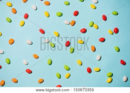 Colorful candies and jellies as background. View from above