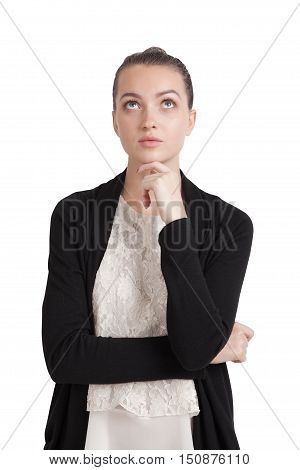 Isolated portrait of young lady wearing black cardigan and lace top looking upwards and thinking. Concept of tough decision making and pondering