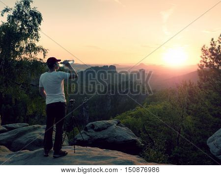 Thirsty Photograph In Black Trousers And White T-shirt With Bottle Of Water