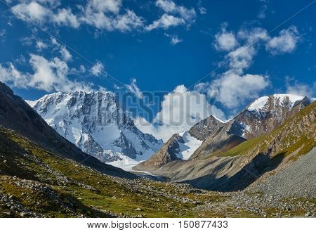 Tian Shan mountains. Kyrgyzstan, Central Asia. Landscape with blue sky and snowy mountains