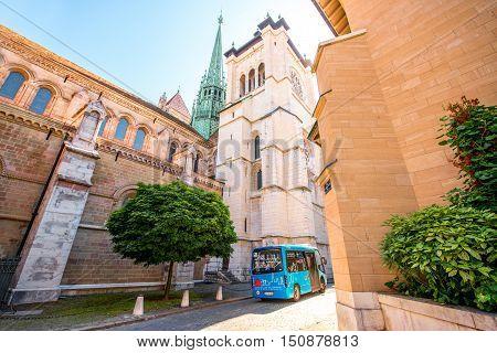 Geneva, Switzerland - June 23, 2016: Saint Pierre church and blue public bus in the old town of Geneva city in Switzerland.