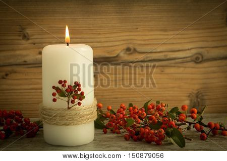 Candles decoration with natural elements. Christmas lighting