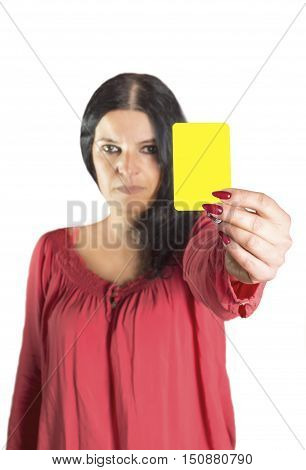 An image of a pretty woman showing yellow card. Selective focus on card