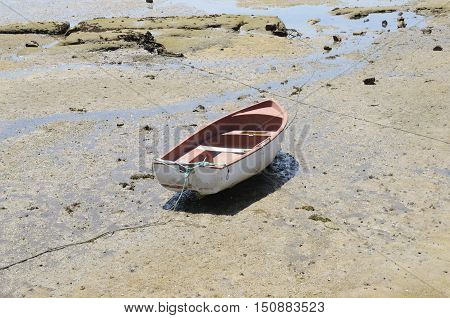 Fishing boat on the shore at the Ria of Pontevedra in the village of Aldan Galicia Spain