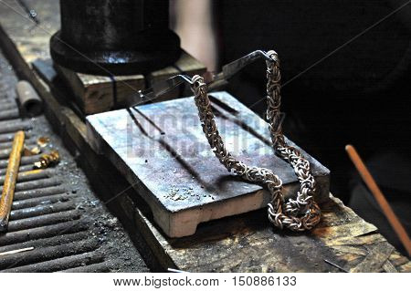 jeweller making silver chain, goldsmith table, process