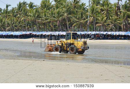 Chonburi Thailand April 5, 2014 bulldozer running for grader smooth sand at Bangsan beach in Thailand