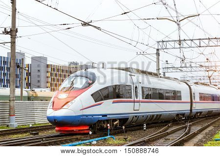 Modern hybrid electric locomotive Sapsan pulling a high-speed train on rails. Technical railway depot. Transport route St. Petersburg - Moscow Russia