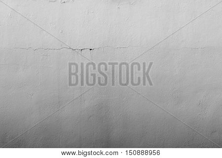 the abstract textured background of an old surface of the plastered wall of a motley gray color tonality