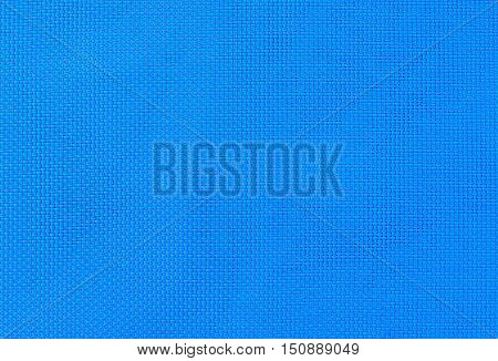 woven texture synthetic fabric with an interlacing of threads of blue color for a background or for wallpaper
