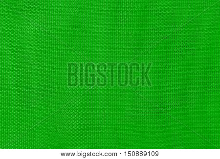 woven texture synthetic fabric with an interlacing of threads of green color for a background or for wallpaper
