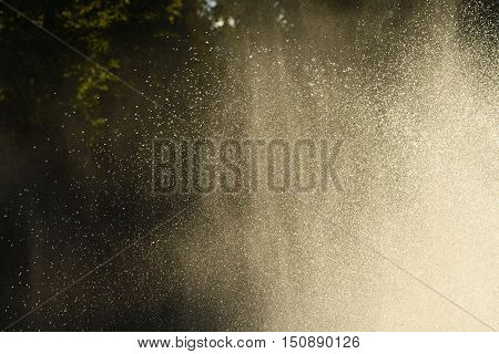 Water drops in the air back-lit backdrop bright