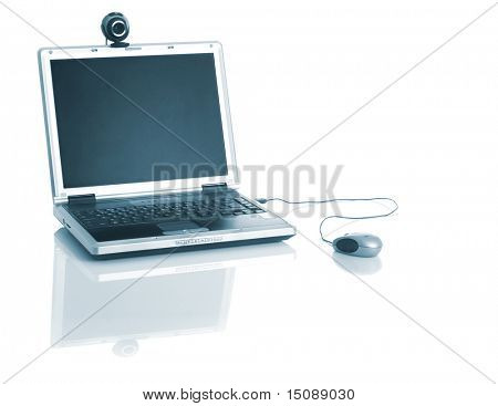 Laptop with a webcam over the table with reflection