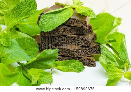 fresh mint and porous chocolate on a white background