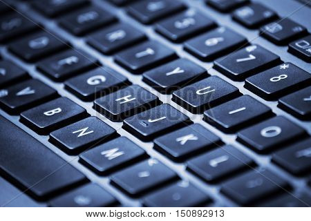 Close-up image of a laptop keyboard with shallow depth of field.